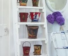 Vintage beach sand pails and buckets can add whimsy and storage to a room, perhaps even bring back some beach memories. Coastal Christmas Decor, Christmas Living Rooms, Beach Living Room, Coastal Living, Seaside Decor, Coastal Decor, Old Ladder Decor, Nautical Furniture, Pail Bucket