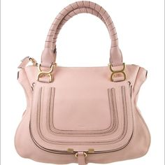 "$1990 Chloe Marcie Pink Satchel Handbag I'm selling my gently used light pink Chloe bag. Like all pieces from the Marcie group, this supple leather bag features bow-shaped buckles on the handle. • Chloe grained calfskin satchel bag with antiqued brass hardware • Wrapped top handles with signature bow-shaped rings, 5.5"" drop • Zip top with fluted edges • Horseshoe flap-pocket on front with tooled Chloe logo on center; slide-ring closure • Interior, fabric lining; one zip and one slip pocket •…"