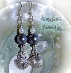 These earrings dangle at 2 inches.  Made with dark silver & white glass pearls with silvertoned shell charms on silver plated hooks.  Handcrafted by me in the USA  Check out my other listings for matching necklace & bracelet :)