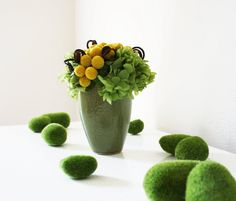 centerpieces- replace moss with succulents and hydrangea with orchids and callas