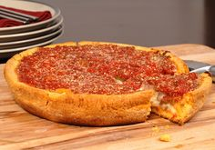 deep dish pizza, Chicago style (and since it's St Patty's Day, have it with a cold Harp)