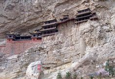 Hanging Monastery - Shanxi. Wooden monastery buildings, first built in 491, are situated on the cliffside of sacred Mount Heng 246 ft above the ground.The 40 buildings are supported by wooden poles; the last rebuilt in 1900.