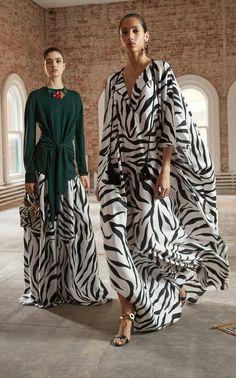 Shop Drape V Neck Zebra Print Caftan. Oscar de la Renta's 'Drape V Neck Zebra Print Caftan' is designed with a plunging v-neckline, puff sleeves cropped at wrist, floor length, with a-line drape silhouette, at floor length. Fashion News, Fashion Outfits, Womens Fashion, Zebra Print Clothes, Kaftan Designs, Mode Kimono, Animal Print Outfits, Caftan Dress, Silk Crepe