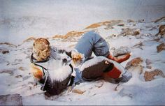 Dead Bodies on Mount Everest - many perfectly preserved bodies lie on top of Mount Everest -It is assumed that this person died while resting against a snow bank which has since evaporated leaving the body in this odd raised position.