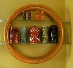 Vintage 1950s Tiki Rattan Circle Wall Shelf with Glass Shelves Great for display of you tiki mugs. $175.00, via Etsy.