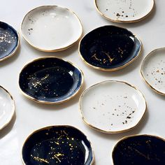 Suite One Studio gold flecked black blue and white ceramic gold rimmed plates | theprettycrusades.com