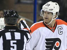 Philadelphia Flyers defenseman Chris Pronger argues with referee Chris Rooney