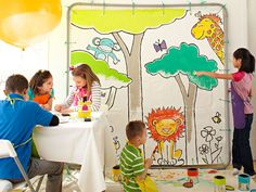 Make a Giant Coloring Page by stenciling a drop cloth and hanging it from pvc pipes and command hooks.