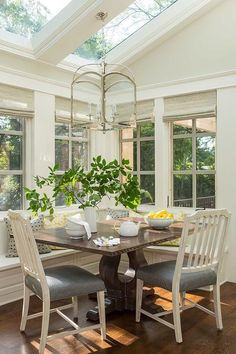 Love the light fixture over the table! Stunning transitional design in Bywood Street Residence.