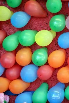 use water balloons filled with air - pop with ?darts (blow up balloons ahead of time and keep in box with lid - tape to board)