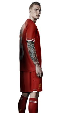 Daniel Agger models the new #LFC home kit for the 2013-14 season.