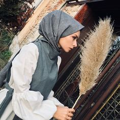 Image may contain: 1 person, outdoor Hijab Fashion, Raincoat, Womens Fashion, Hijabs, Image, Clothes, Instagram, Allah, Dresses