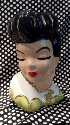 Check out this item in my Etsy shop https://www.etsy.com/listing/205668102/vintage-lady-head-vase-1950-60s-lime
