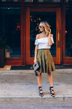 Perforated white off the shoulder top + olive green skirt + black lace-up heels