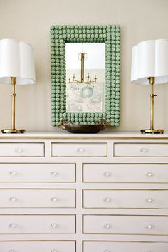 There's a lot to admire in this simple setting.  A design from Urban Grace Interiors tells so much without making a big fuss.  Soft whites, creams and golds, and that fascinating, amazing mirror.  A vignette in elegant taste and sweet symmetry.