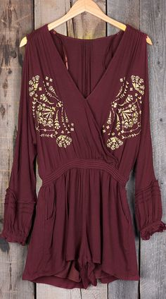 This romper is sure to capture everyone's attention! We love that shoulder cut and amazing embroidery! This is a must-have in your wardrobe!