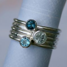 Five sterling-silver stacking rings, three stones (aquamarine, Swiss blue topaz,  London blue topaz)