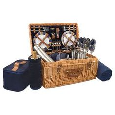 "39-Piece picnic basket set with an insulated wine duffel and two food storage containers.    Product: 1 Basket4 Plates 4 Wine glasses  4 Forks 4 Knives 4 Spoons 1 Cheese knife1 Cutting board 1 Corkscrew1 Bottle stopper1 Salt and pepper shaker 4 Napkins1 Insulated wine duffel 2 Food storage containers 1 Vacuum flask  4 Coffee mugs 1 Picnic blanketConstruction Material: Willow, hardwood, stainless steel, glass and fabricColor: Navy   Dimensions:   Overall: 14.5"" H x 23.5"" W x 11"" D   Blanket…"