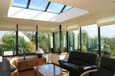 www.maison-extension.com/files/2011/10/veranda-toiture-plate.jpg