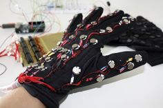 HAPTICS is a tactile feedback technology which takes advantage of the sense of touch by applying forces, vibrations, or motions to the user. Here's an early prototype for a glove that enables vision/hearing impaired to text messages. Send Text Message, Text Messages, Learn Robotics, Braille, Machine Vision, E Textiles, Cool Tech, Virtual Reality, Augmented Reality
