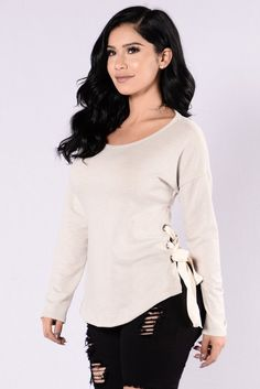 - Available in Oatmeal - Scoop Neckline - Lace Up Sides - Long Sleeve - 87% Polyester, 9% Rayon, 4% Spandex