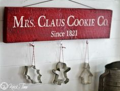 Rustic Christmas Sign - 12 Days of Christmas {Day 5} - Knick of Time.  I love the cookie cutters dangling.  Maybe use my antique ones?