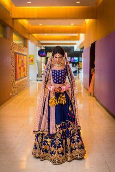 Bridal Wear - Eham & Nami wedding story   WedMeGood   Blue and Pink Wedding Lehenga with a Net Dupatta and Gold Embroidery #wedmegood #indianbride #indianwedding #bridal #lehenga #gold #bridallehenga #weddinglehenga #blue