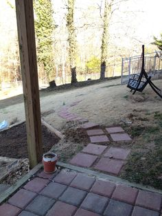 Long term plan is to take the walkway over to the fence. For now, just around the new garden spot.