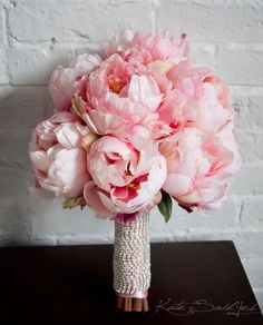 I hope my peonies grow so I can make this bouquet for my daughters.Blush Pink Peony Bouquet with Rhinestone Handle von KateSaidYes Bouquet Bride, Peony Bouquet Wedding, Pink Rose Bouquet, Peonies Bouquet, Pink Peonies, Wedding Flowers, Flower Bouquets, Bridal Bouquets, Yellow Roses