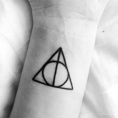 This simple reminder of Harry Potter and the Deathly Hallows:   33 Magnificent Tattoos Inspired By Movies