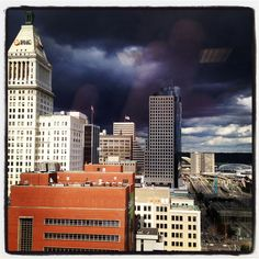 A storm rolls over Downtown, Cincinnati, as seen from the 19th floor of The Enquirer Building. (The Enquirer/Liz Dufour)