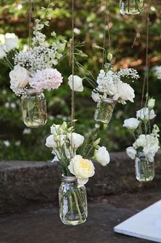 Floral clusters in mason jars (flowers by Lee Forrest Design, photo by Tab McCausland Photography)