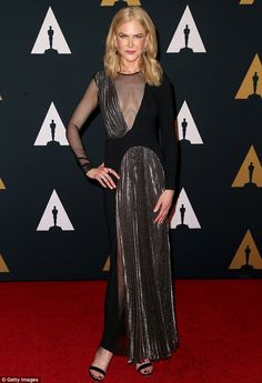 Blonde beauty:Nicole Kidman wore a charcoal and black gown that showed a hint of her clea...