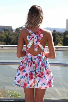 Cute floral dresses can be worn for a day at the beach or going to a summer bbq, perfect must have for summer time! This one has a bow and crossing straps that make it a little dressier than others :)
