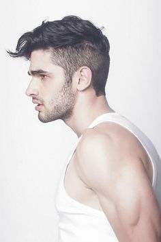 This is the hair style I'm going for. SHORT BACK AND SIDES With short back and sides and a long layer on top, this hairstyle sweeps over the head, and gradually tapers to a tip at the front. It's an ideal choice for men who want to add a touch of uniqueness to their style.