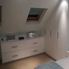 Open plan study with bedroom and bathroom in a dormer for Eaves bedroom ideas