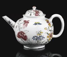 A RARE MEISSEN BÖTTGER PORCELAIN DUTCH-DECORATED TEAPOT AND COVER, CIRCA 1713 of globular form painted in thickly applied enamels with winged insects above flowering peonies and prunus, the cover with a similar flowering branch and insect, minor chips and haircrack.