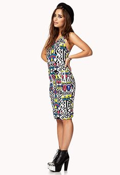 A bodycon dress featuring a 90's retro print. Scoop neckline. Sleeveless. Unlined. Knit. Lightweight.
