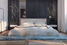 In the bedrooms, soft, luxurious textures take over. Soft shag rugs create pools of comfort around platform beds while black molded walls give the room just a souissant of industrial appeal. A padded headboard and velvety coverlets give the second bedroom its own indulgent design as well.