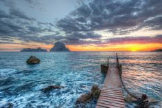 I took photos all throughout the sunset, before and after. I visited this spot 3 different times. Of the three times, this was one of the best. There was about a quarter-mile strip of beach and rock, all of which had good angles. So I kind of worked my way back and forth as the light changed… - Ibiza, Spain- Photo from #treyratcliff Trey Ratcliff at http://www.stuckincustoms.com/