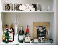 Bar - White shelves filled with bar essentials and glassware