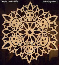 How to make skull paper snowflakes