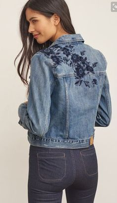 Classic style in a medium wash featuring two front button chest pockets, two side welt pockets, subtle distressed details, button front and cuffs accented with tonal, and floral embroidery on shoulders and back. Embroidered Denim Jacket, Embroidered Clothes, Jean 1, Denim Ideas, Denim And Lace, Denim Shirt, Embroidery Designs, Floral Embroidery, Diy Clothes