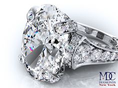 Large Oval Diamond Cathedral Graduated pave Engagement Ring 1.25 tcw. In Platinum