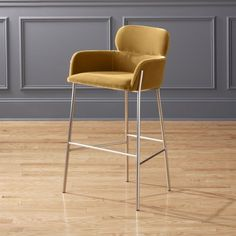 "Shop Azalea Champagne 30"" Bar Stool. Designed by Caleb Zipperer and curved with two tiers of comfort. Retro champagne-colored bar stool invites guests to stay and sip a while. Sits plush with bottom tier sized right for arm resting. CB2 exclusive."