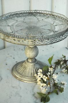 Love this  old metal cake stand...