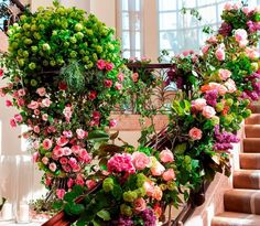 At the bottom of the staircase a grand floral tree greeted guests (Venue: @bevhillshotel   Planner: @internationaleventco   Florist: @marksgarden   Photographer: @sterlingphoto   Videographer: @vidicamproductions   Band: @westcoastmusicbevhills   Sound: @design.sound   DJ: @audiovisualenter   Décor: @revelryeventdesign @revelrymatias   Lighting: @images_lighting   Chairs/Rentals: @classicparty   Linens/Napkins: @wildflowerlinen   Dance Floor: #CalendarFloors   Chargers: @tacer_losangeles…