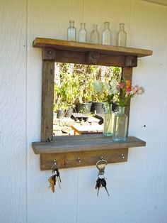 Reclaimed wood Rustic Craftsman Style Mirror with Shelves and Hooks - Custom Order. $69.95, via Etsy.