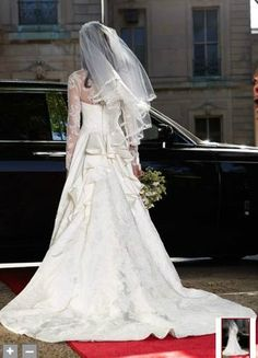 Kate Middleton..I have never seen this pic before!  It seems to be Kate waiting to get into th car that would take her to the wedding!  Beautiful moment!