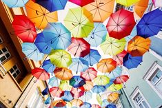 Agueda, Portugal - rainbow in the form of hundreds of multicolored umbrellas suspended above the length of the Rua Luis de Camões. While the shady addition was initially intended to be temporary, Águeda's umbrellas return every July without fail. Colorful Umbrellas, Photo Print, Ipoh, Art Festival, World Heritage Sites, Fractals, Free Photos, Stock Photos, Creative